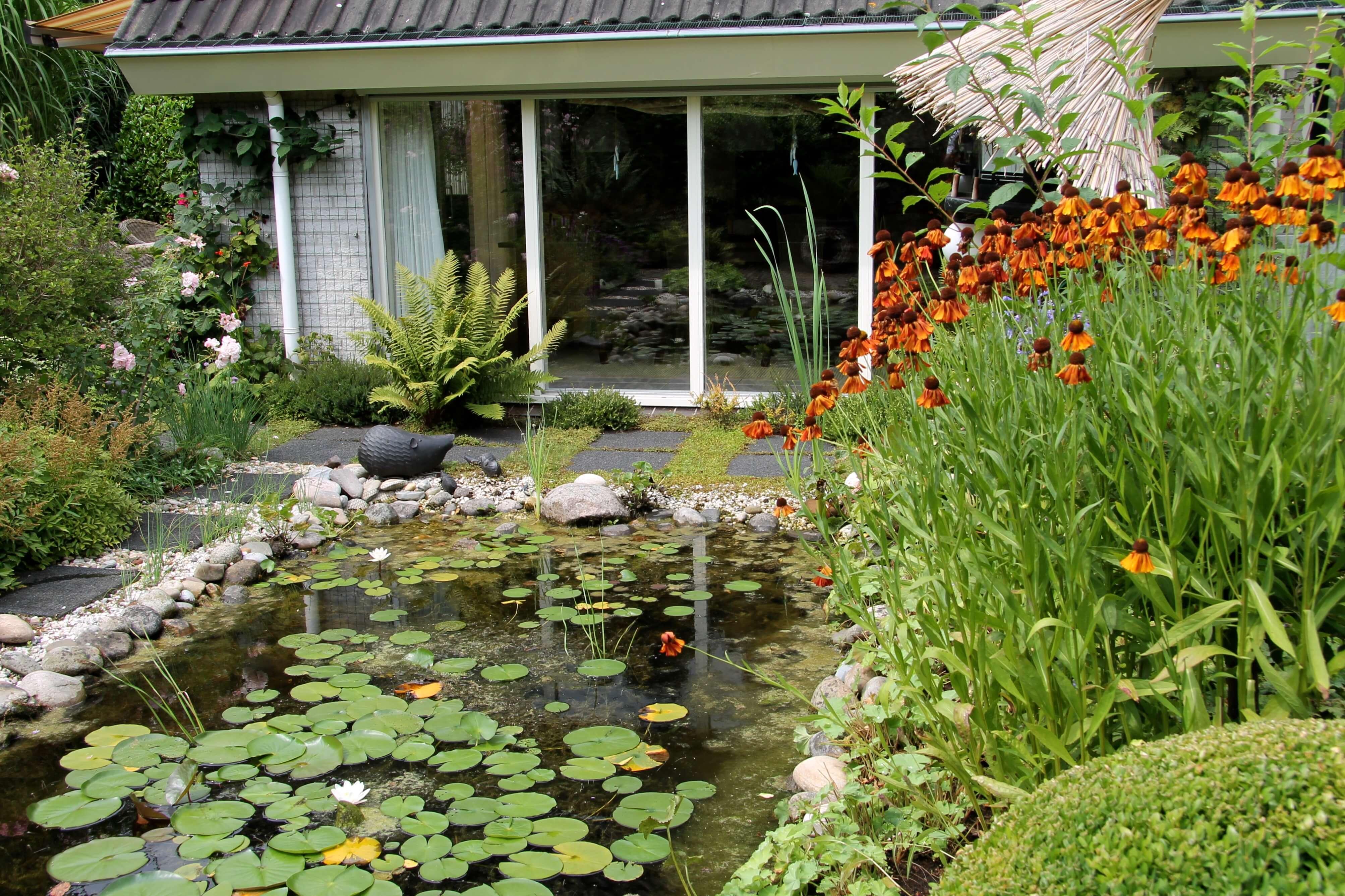 Volgroeide romantische tuin uit 1991 - Exclusieve Tuinen